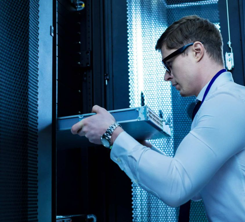 modern-equipment-serious-professional-operator-working-with-server-equipment-office